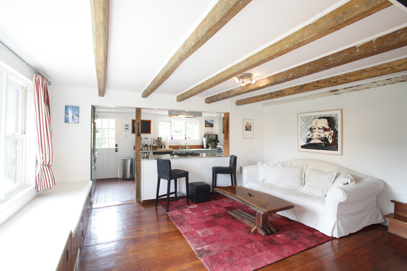 Living room with exposed wooden beams.